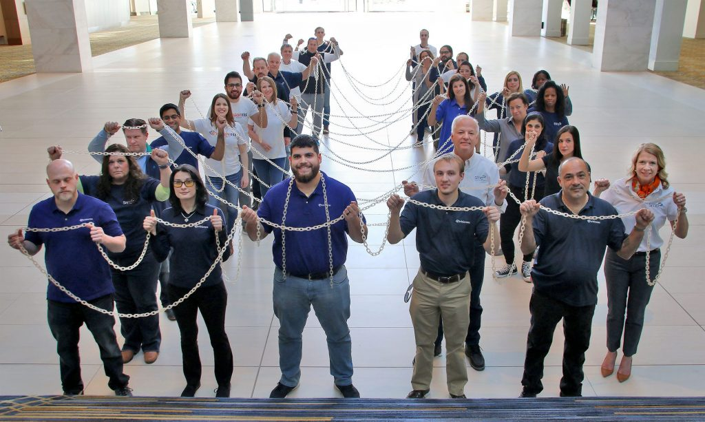 EnvisionTec team holds the longest 3D printed chain printed in E-RigidForm